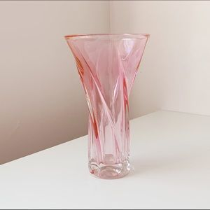 tall pink glass twist vase with a large opening